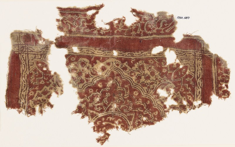Textile fragment with medallion, floral patterns, and Persian-style script