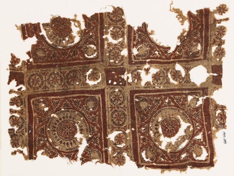 Textile fragment with squares, elaborate rosettes, and circles