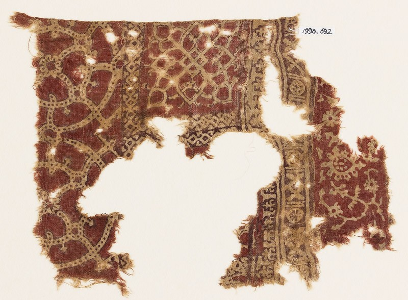 Textile fragment with interlocking circles, interlaced tendrils, and flower-heads