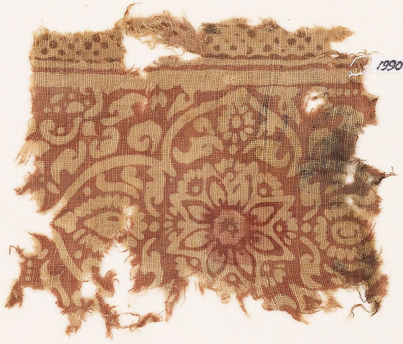Textile fragment with medallion, flowers, and leaves