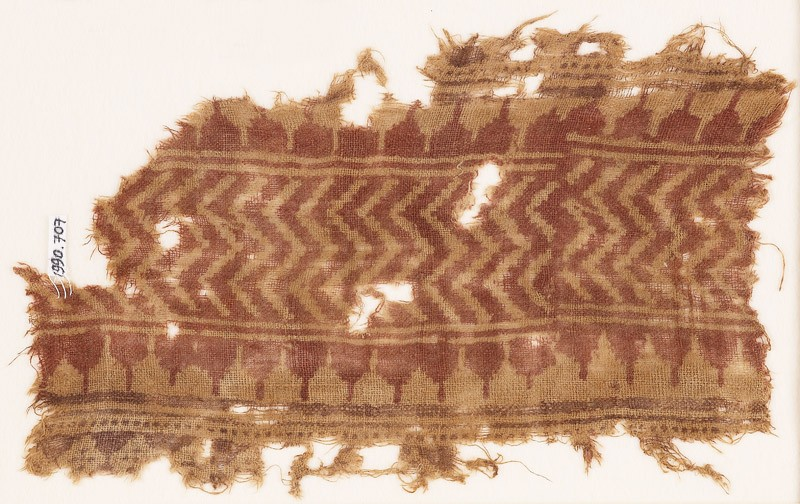 Textile fragment with chevrons and crenellations