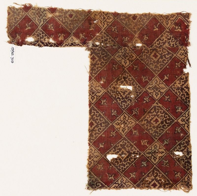 Textile fragment with linked squares, tendrils, and quatrefoils (front            )