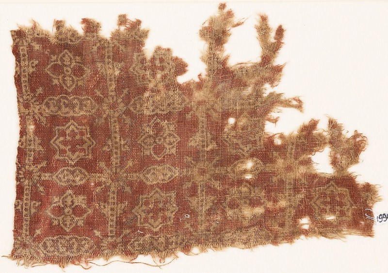 Textile fragment with grid, quatrefoils, and stars