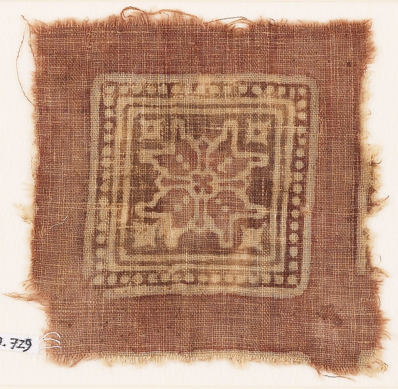 Textile fragment with dotted square and rosette