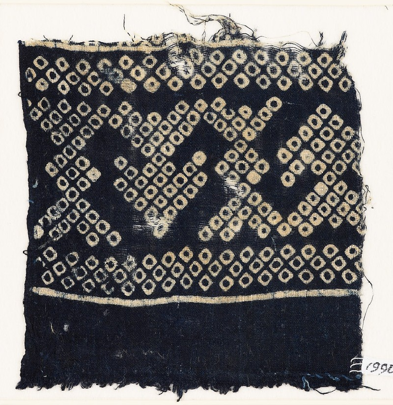 Textile fragment imitating bandhani, or tie-dye, with geometric patterns and arrow-shapes (EA1990.73, front           )