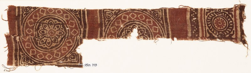 Textile fragment with squares, circles, and rosettes (front            )