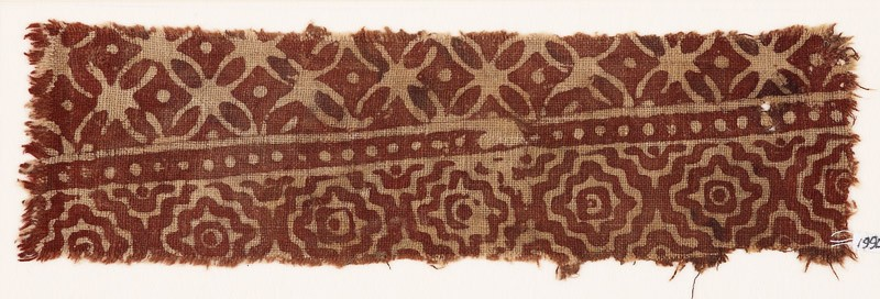 Textile fragment with interlocking diamond-shapes and quatrefoils