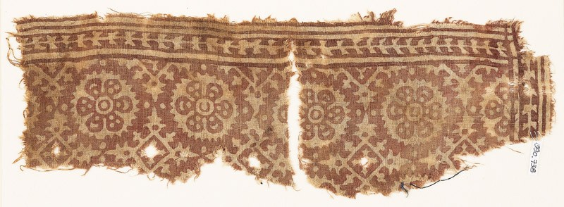 Textile fragment with rosettes and four-pointed stars (EA1990.738, front            )
