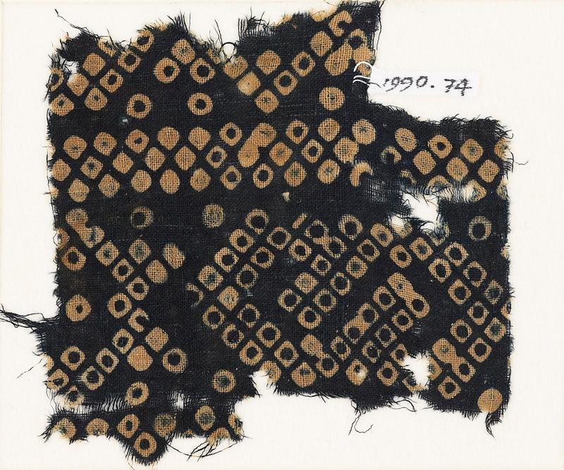 Textile fragment imitating bandhani, or tie-dye, with inverted hooks