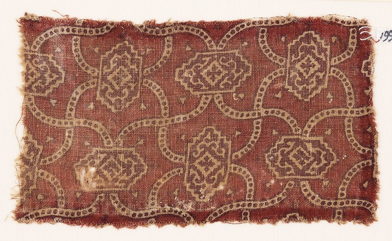 Textile fragment with linked medallions and cartouches