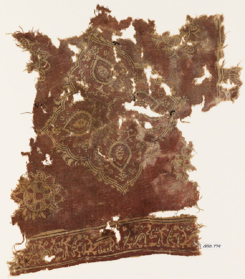 Textile fragment with floral medallion and Persian-style script (EA1990.774, front            )