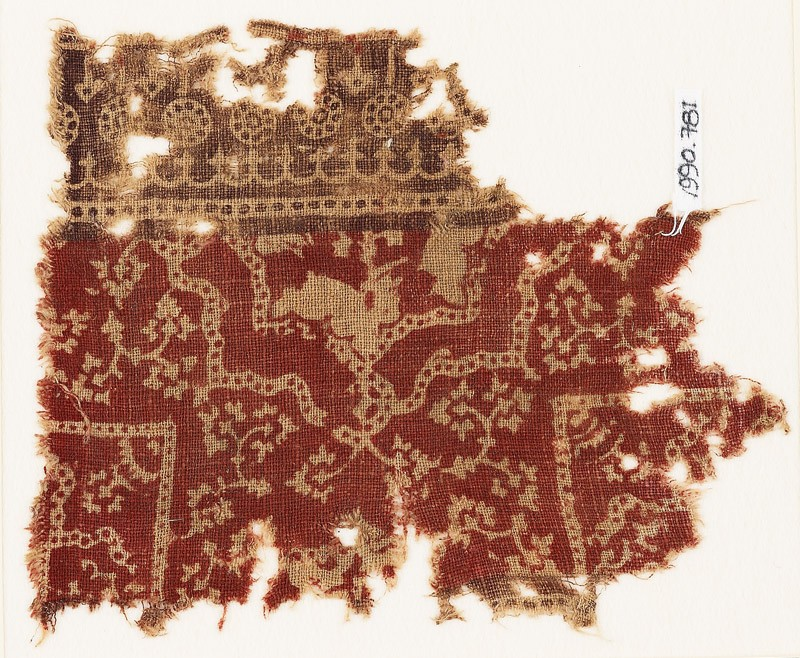 Textile fragment with half-medallion, parts of squares, and flowers