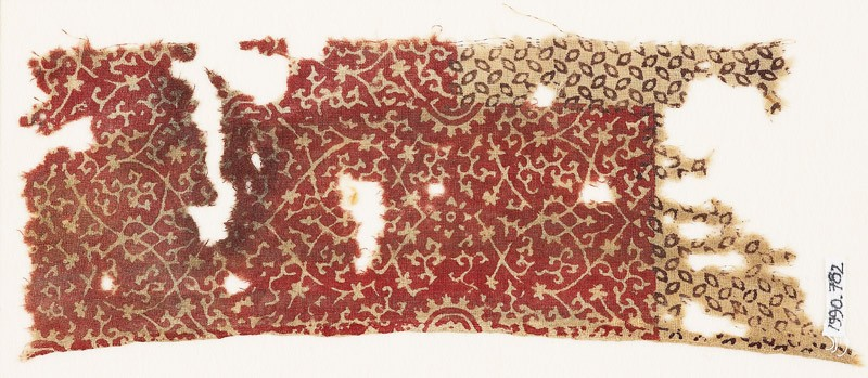 Textile fragment with oval medallions and petals or grains (front            )