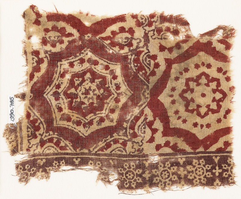 Textile fragment with large medallions, rosettes, and snowflakes (front            )