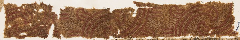 Textile fragment with swirling shapes