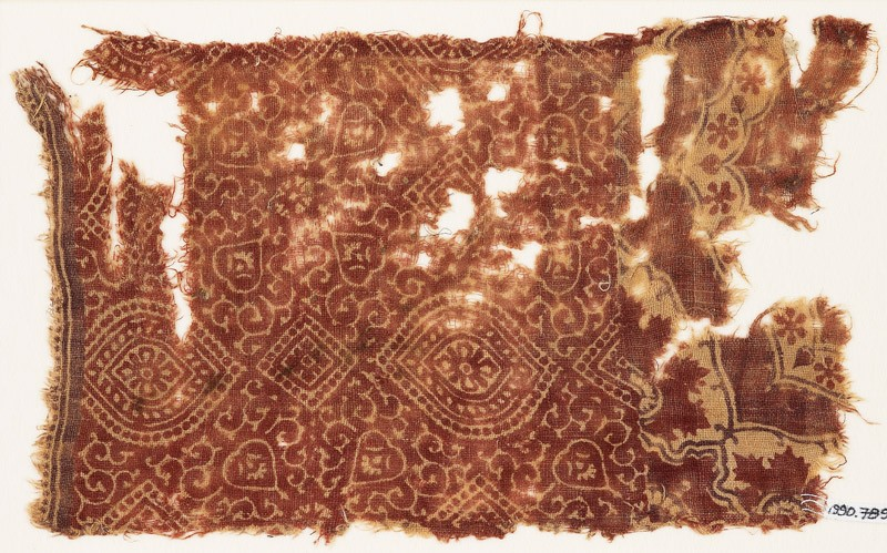 Textile fragment with pointed ovals, squares, and tendrils