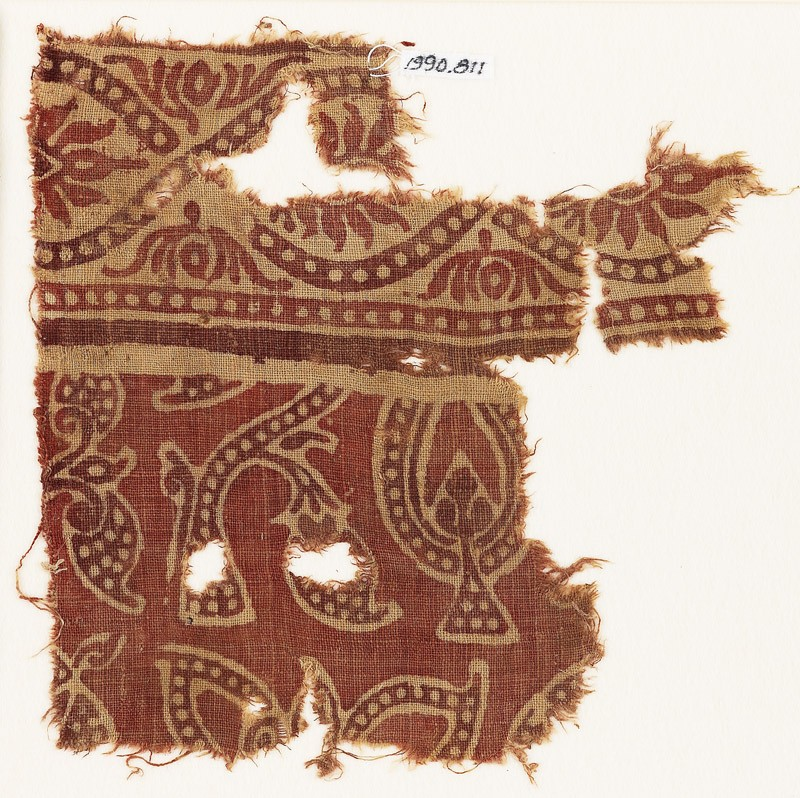 Textile fragment with dotted leaves, interlace, and flowers (EA1990.811, front            )
