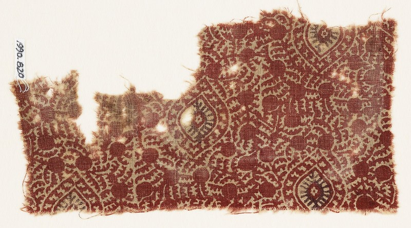 Textile fragment with oval medallions, tendrils, and possibly berries