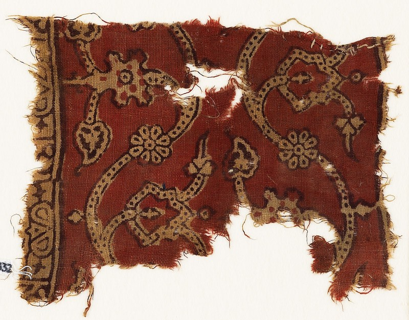 Textile fragment with dotted tendrils, leaves, and rosettes
