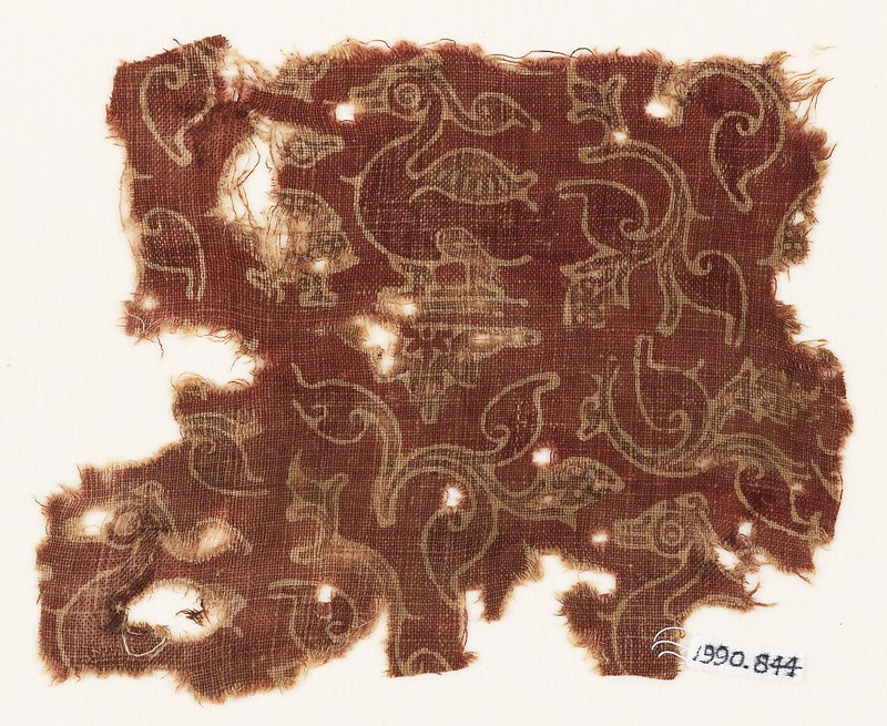 Textile fragment with leaves, hamsa, or geese, and quatrefoils