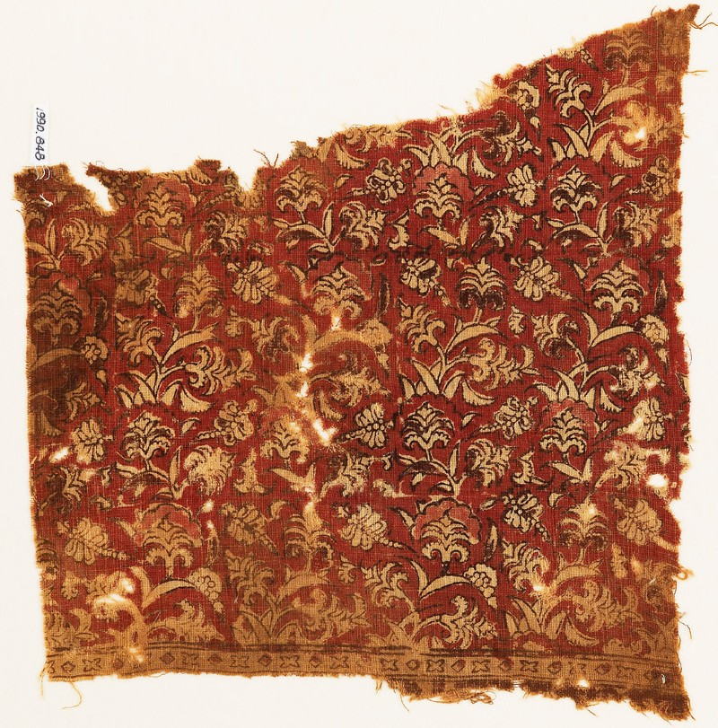 Textile fragment with dragonflies and flowering plants