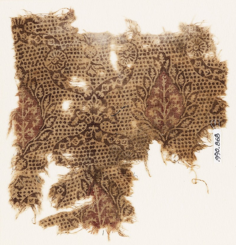 Textile fragment with interlace, flowers, and leaves (EA1990.868, front            )