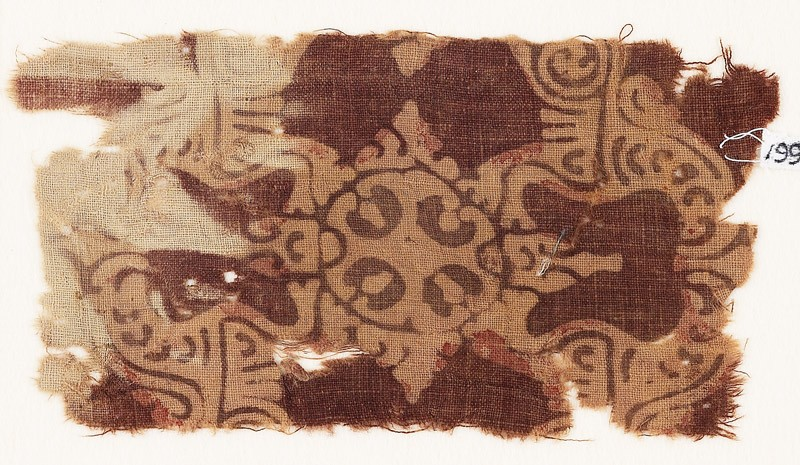 Textile fragment with ornate quatrefoil or medallion
