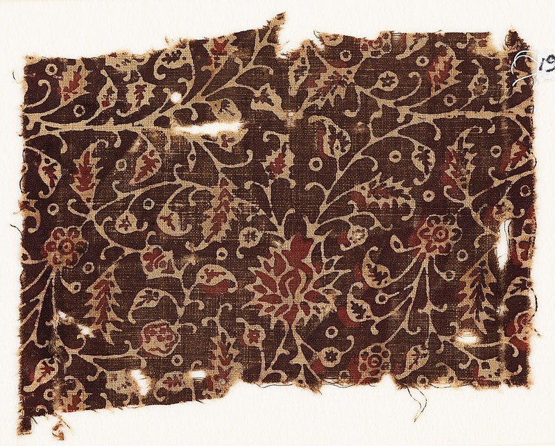 Textile fragment with tendrils and flowers, possibly from a garment (EA1990.883, front            )