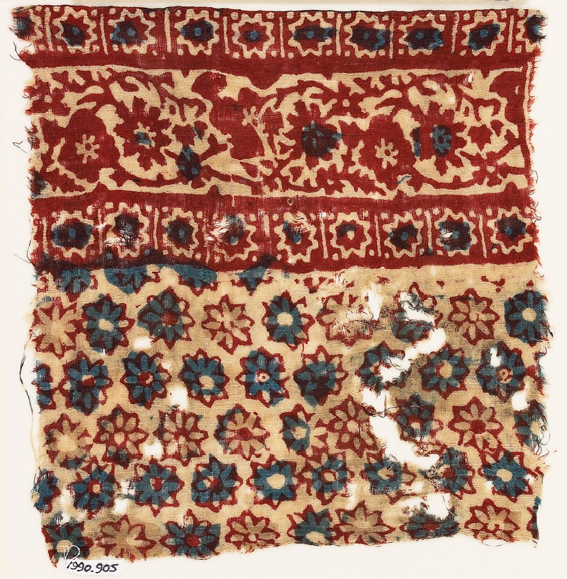 Textile fragment with rosettes and vine (front            )
