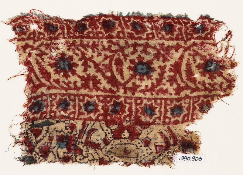 Textile fragment with vine and stars (front            )