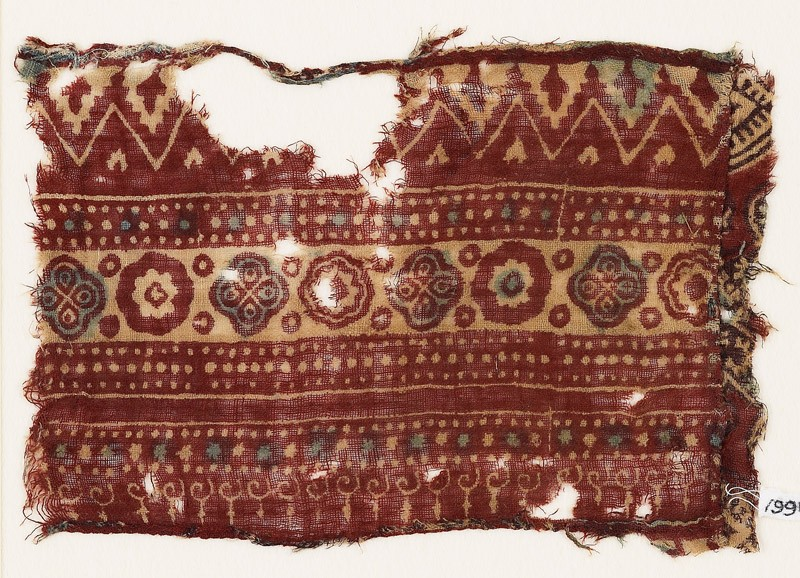Textile fragment with bands of quatrefoils, rosettes, and chevrons (EA1990.907, front            )
