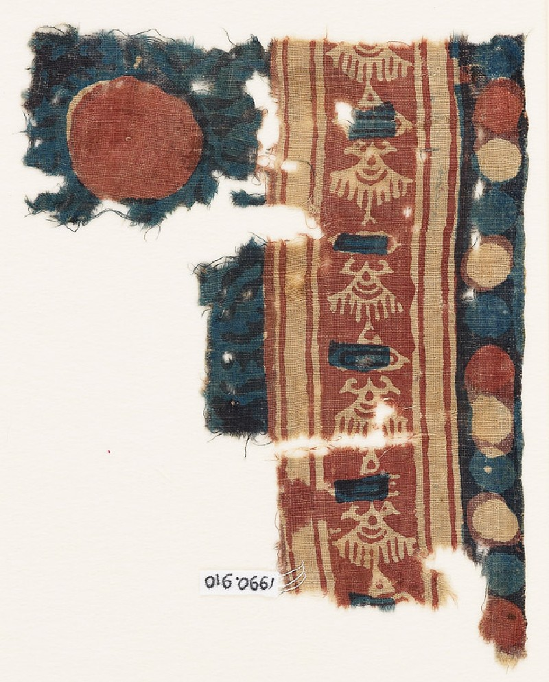 Textile fragment with stylized shapes, possibly birds (EA1990.910, front            )