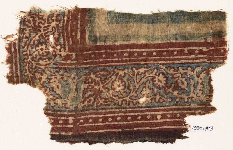 Textile fragment with vine, leaves, and flowers