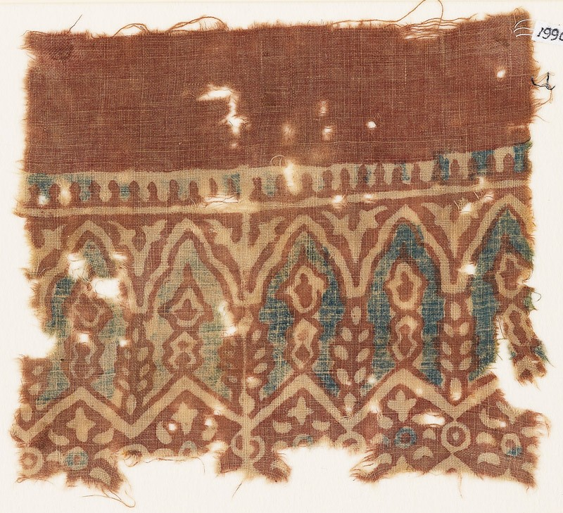 Textile fragment with arches and stylized plants