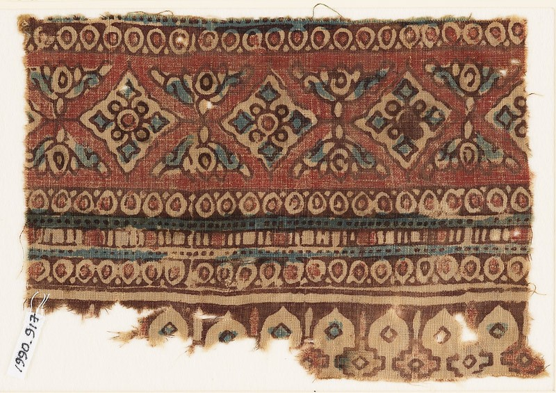 Textile fragment with diamond-shapes, circles, and arches