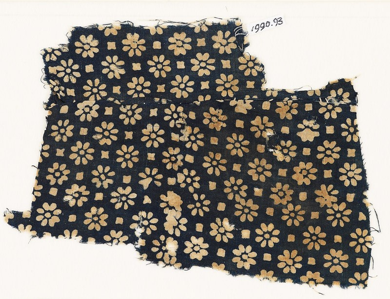 Textile fragment with rosettes and small squares