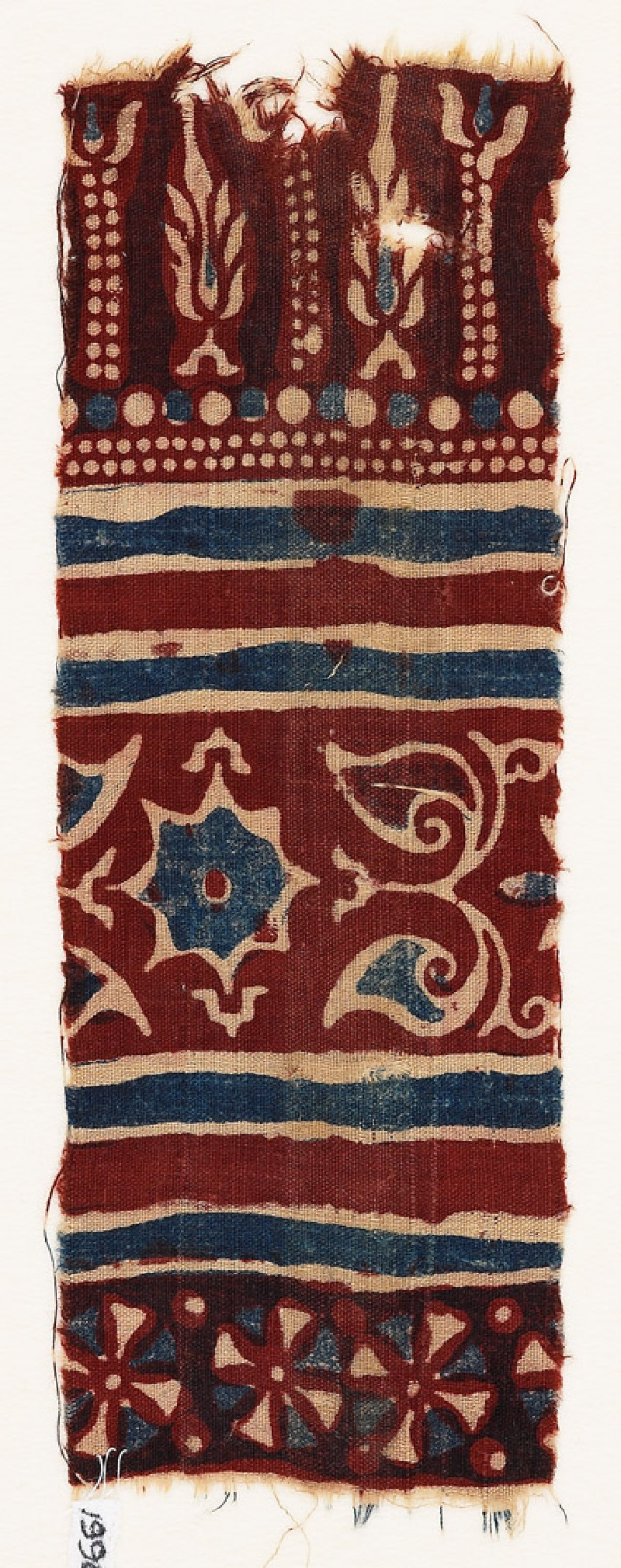 Textile fragment with stylized trees, a star, and leaves