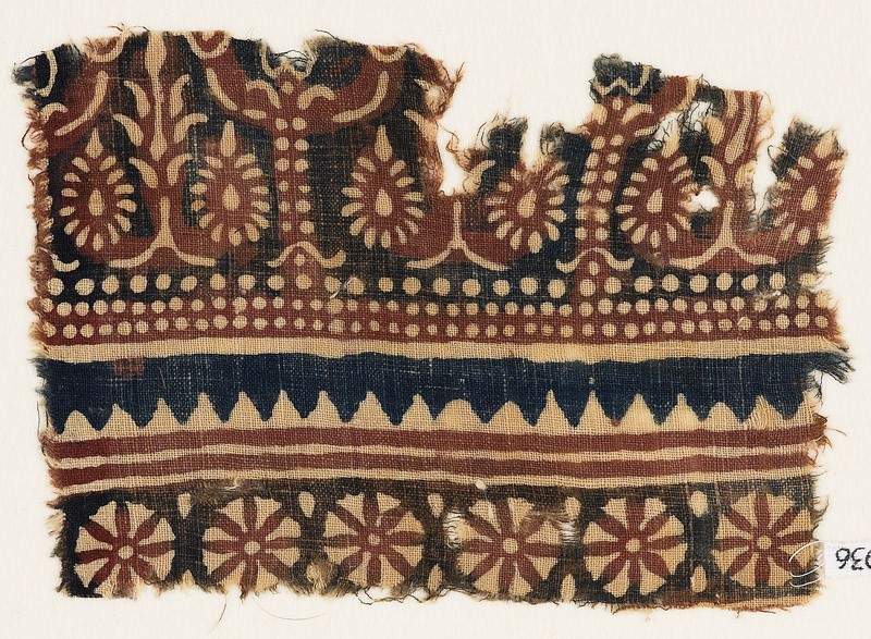 Textile fragment with flowering trees and rosettes