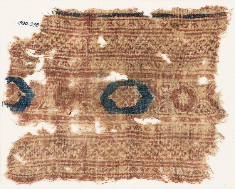 Textile fragment with bands of crosses and medallions