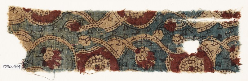 Textile fragment with interlacing tendrils and flower-heads (EA1990.944, front            )