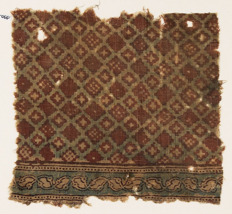 Textile fragment probably imitating patola pattern, with a grid of stepped diamond-shapes (EA1990.945, front            )