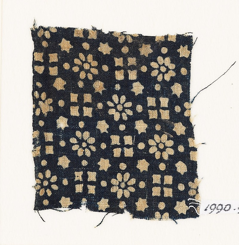 Textile fragment with rosettes, stars, and squares (EA1990.95, front           )