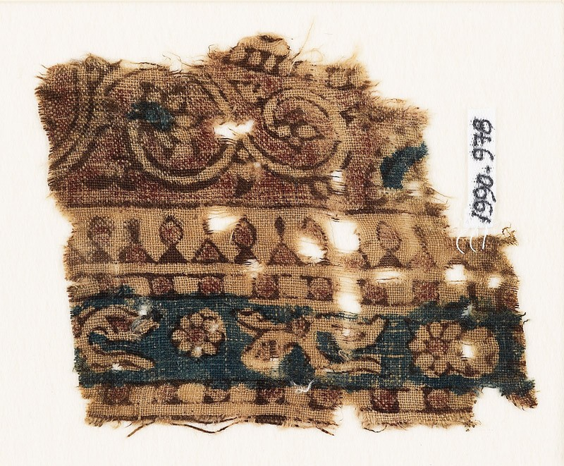 Textile fragment with leaves, rosettes, and vine