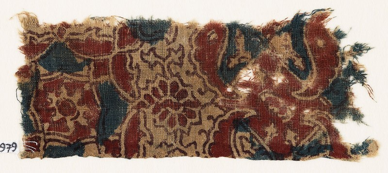 Textile fragment with medallion, wings, and rosettes