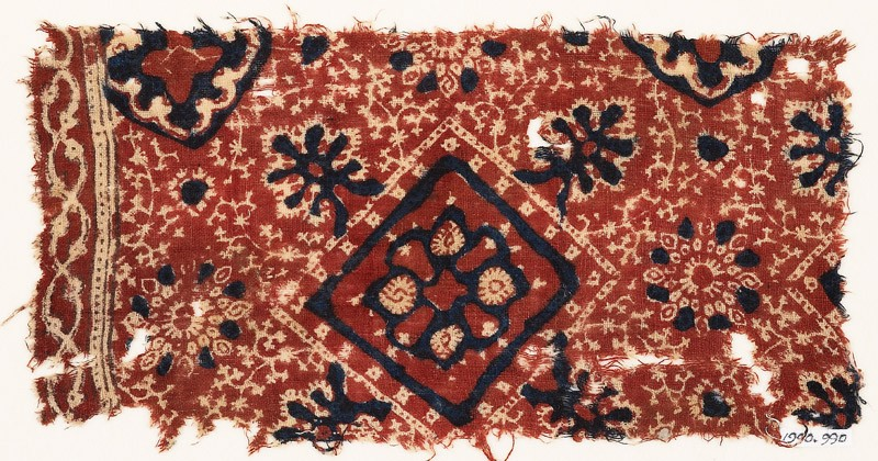 Textile fragment with square, flower-heads, rosettes, and medallions (front            )