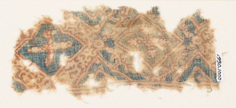 Textile fragment with quatrefoils and tendrils