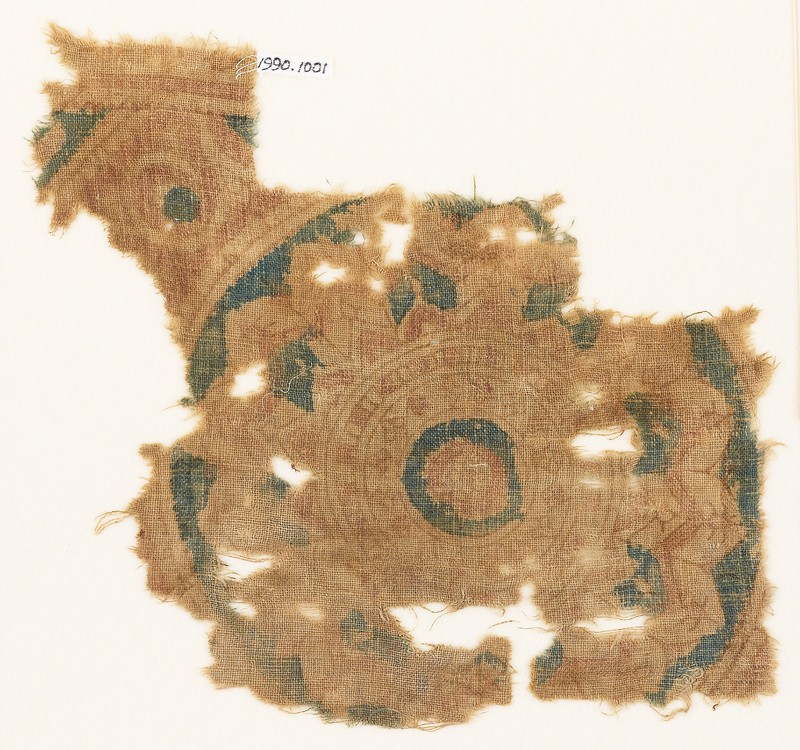 Textile fragment with part of a large rosette