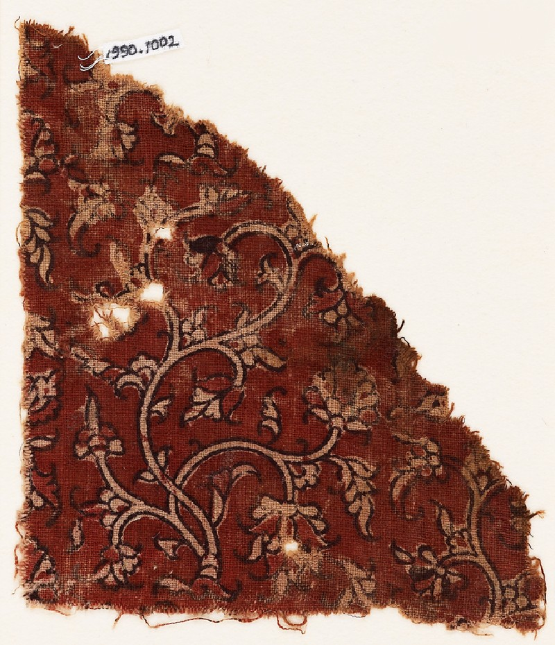 Textile fragment with stylized plants and stems