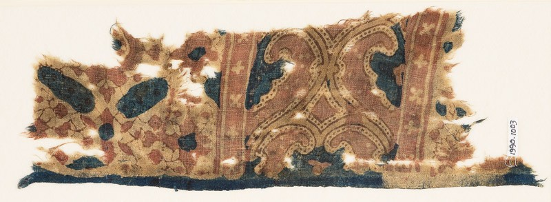 Textile fragment with curving tendrils (front             )