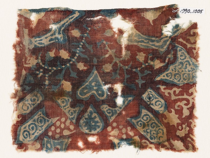Textile fragment with tendrils, hearts, and tab-shapes (front             )